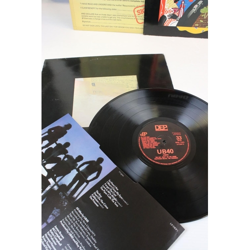 496 - Vinyl - UB40 4 LP's to include Signing Off, Present Arms, Labour Of Love and UB44.  Sleeves & Vinyl ...