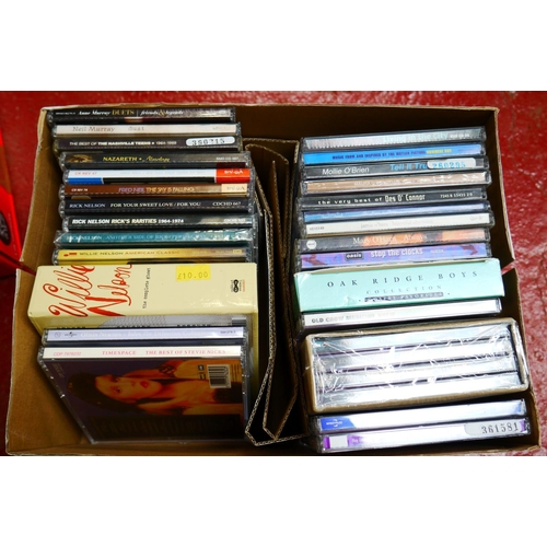 556 - CD's - Over 300 CDs spanning the genres and decades to include many Country examples and compilation...