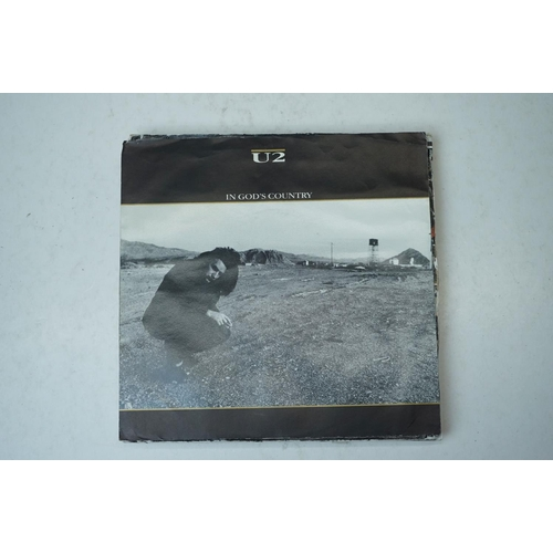 871 - Vinyl - 11 U2 45s mainly without sleeves to include In Gods Country (picture sleeve), New Years Day,...