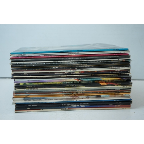 877 - Vinyl - Around 35 LPs mainly Rock, Pop, MOR & Easy Listening to include Rod Stewart, Bruce Springfie...