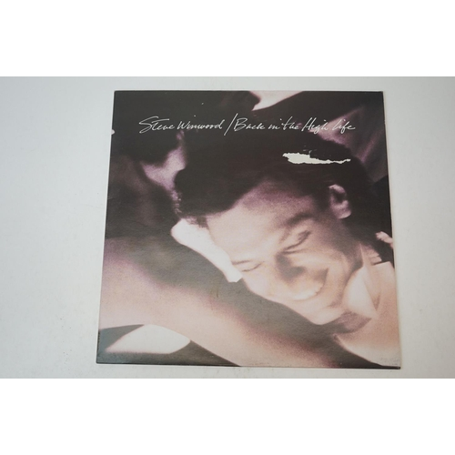 169 - Vinyl - Four Steve Winwood LPs to include self titled, Back in the High Life (tear to sleeve), Refug...