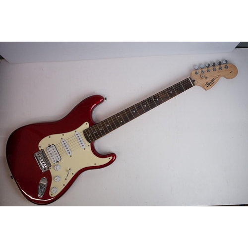 749 - Guitar - Fender Squire strat style electric guitar in red with soft case