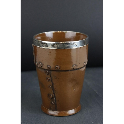 18 - A Doulton Silicon antique silver mounted beaker in the form of a studded copper cup.