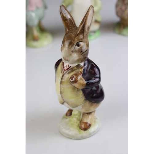 19 - Seven Beswick Beatrix Potter figures to include Squirrel Nutkin gold back stamp , Tabitha Twitchett ...