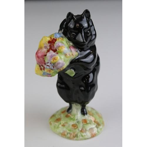 23 - A Beswick Beatrix Potter cat figure of Duchess black body holding multi coloured posy of flowers Gol...