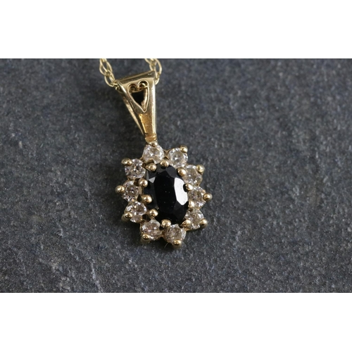 24 - A contemporary 9ct gold diamond and sapphire set pendant and necklace.