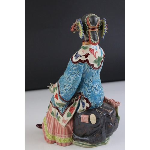27 - An Oriental Shi Wan ceramic pottery figure of  a seated  lady.