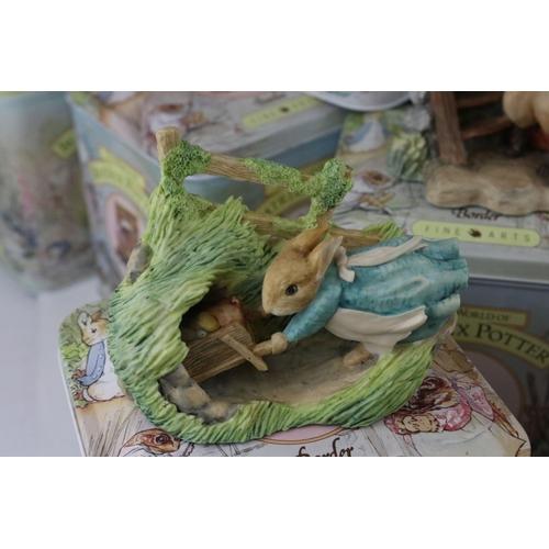 34 - A set of twelve Border Fine Arts Beatrix Potter figures in tins to include Hunca Munca,Tailor Of Glo...
