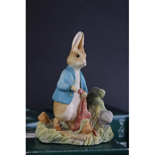 36 - Nine boxed Border Fine Arts Tales Of  Beatrix Potter figures to include Hunca Munca and the Babies, ...