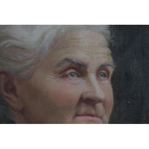 38 - A 19th century oval gilt framed oil on board of an elderly woman with indistinct signature.40 x 33 c...