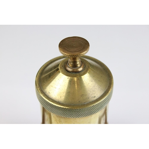 53 - A brass vintage Steam Car oil valve mounted on a wooden plinth.