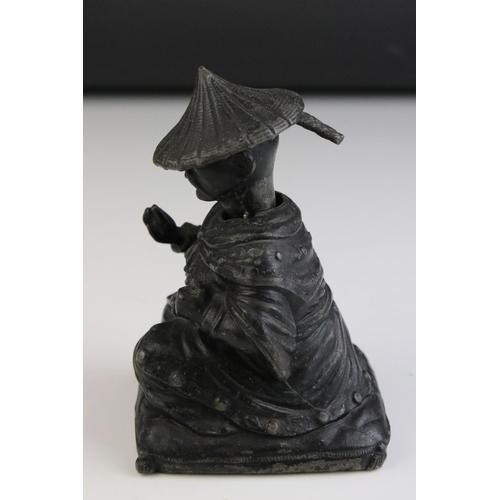 59 - An early 20th century spelter figure of a nodding Oriental man.