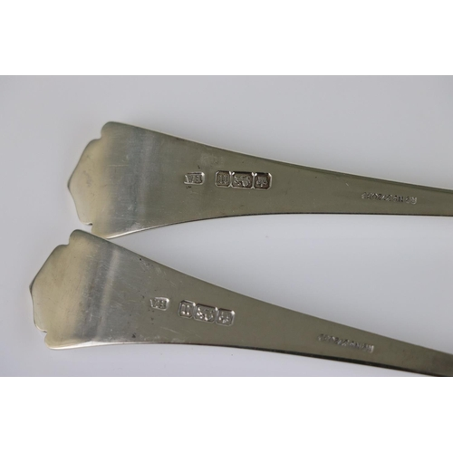 189 - Pair of Edwardian silver serving spoons, crimped detailing to bowls, Albany style terminals, makers ...