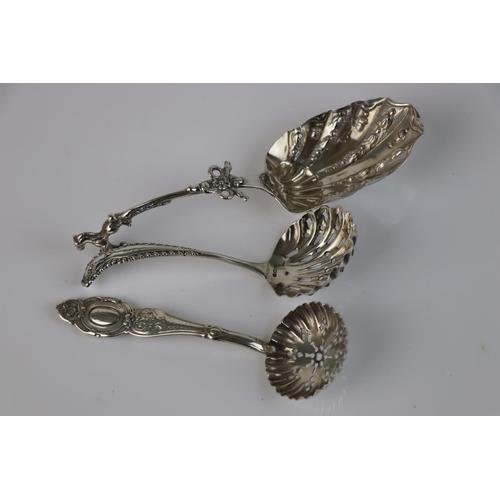 194 - Two silver sugar sifter spoons, makers William Devenport, Birmingham 1907 and Elkington & Co LTd, Bi...