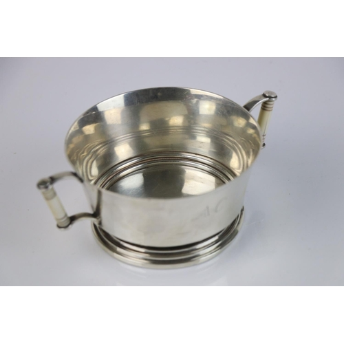 213 - A fully hallmarked Britannia silver double handled christening cup with decorative ivory handles, ma...