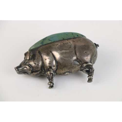 235 - A fully hallmarked sterling silver pin cushion in the form of a pig, hallmarks rubbed and indistinct...