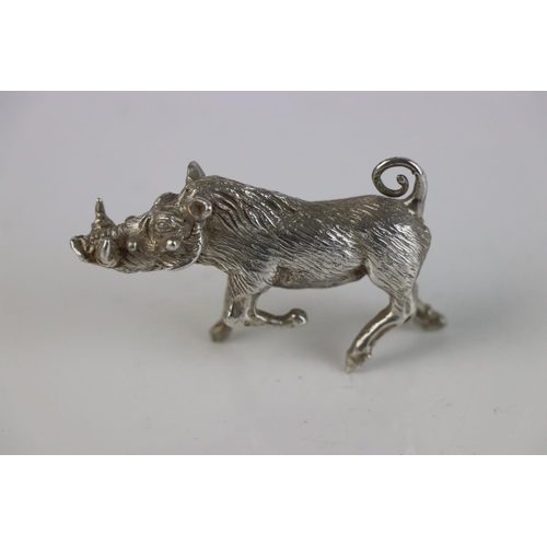 249 - A solid 958 Britannia silver miniature figure of a Wart Hog, marked 958 to the underside.