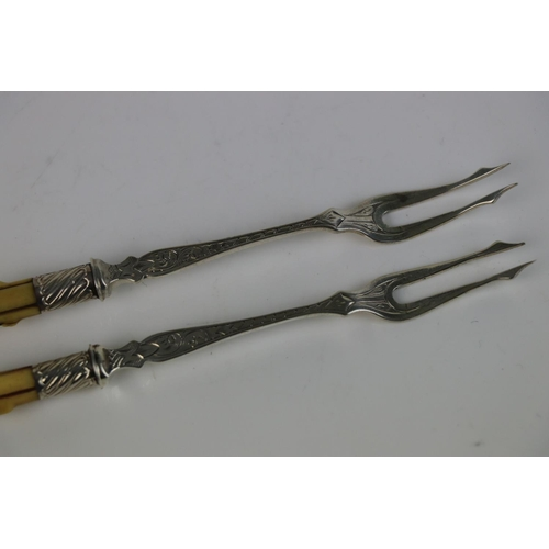 261 - A pair of Victorian fully hallmarked sterling silver pickle forks with bone handles, indistinct make...