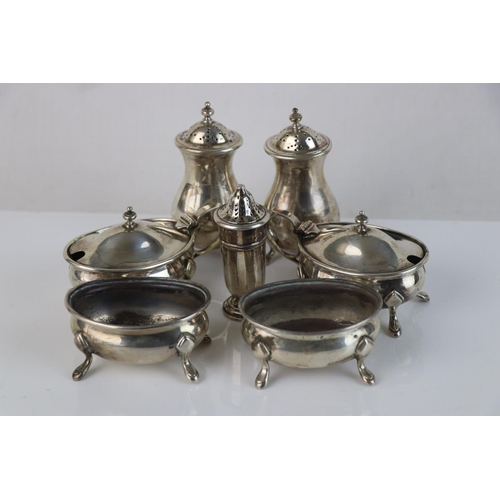 281 - A fully hallmarked sterling silver cruet set comprising of two salts, two mustards, two salt shakers...