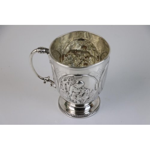 294 - A fully hallmarked sterling silver mug with handle to the opposite a monogram panel, finely embossed...