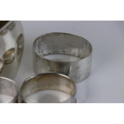 296 - A fully hallmarked sterling silver cream jug together with three fully hallmarked sterling silver na...