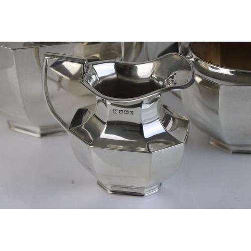 298 - A fully hallmarked sterling silver three piece tea service, comprising tea pot, twin handled sugar b...