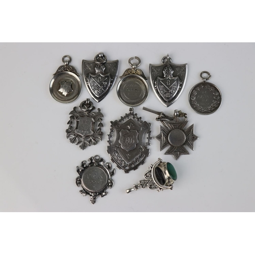 316 - A collection of nine fully hallmarked sterling silver watch fob medallions together with a silver an...