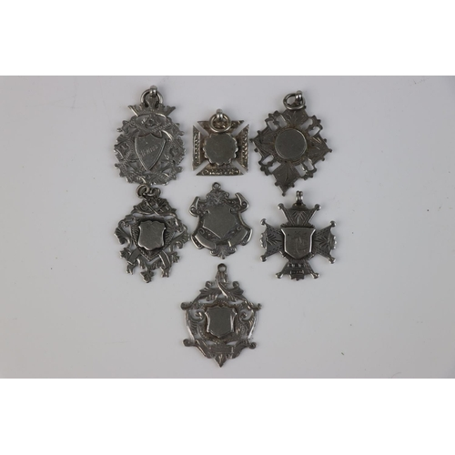 317 - A collection of eight fully hallmarked sterling silver watch fob medallion.