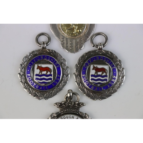 318 - A collection of Four fully hallmarked sterling silver Football related watch fob medallions.