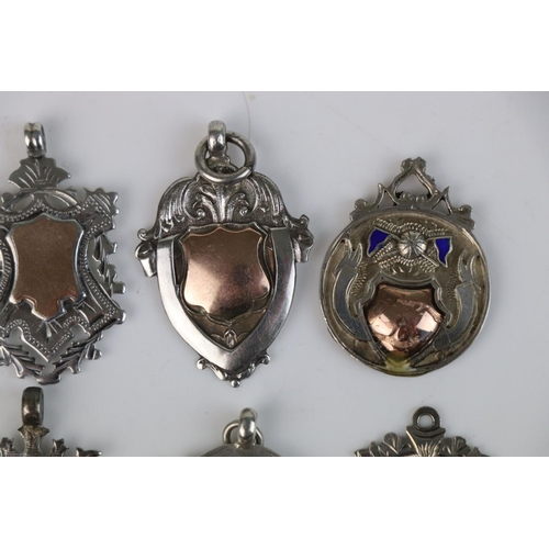 319 - A collection of six fully hallmarked sterling silver watch fob medallions.