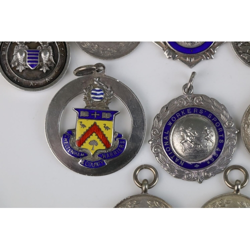 320 - A collection of Twelve fully hallmarked sterling silver sports related watch fob medallions.