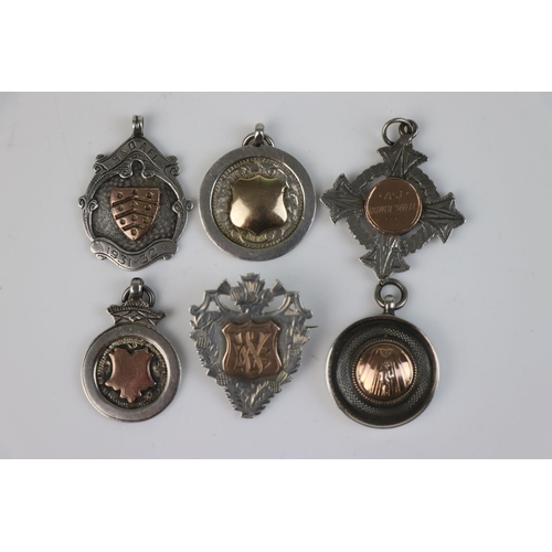 323 - A collection of six fully hallmarked sterling silver watch fob medallions.