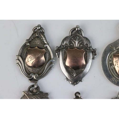 324 - A collection of six fully hallmarked sterling silver watch fob medallions.