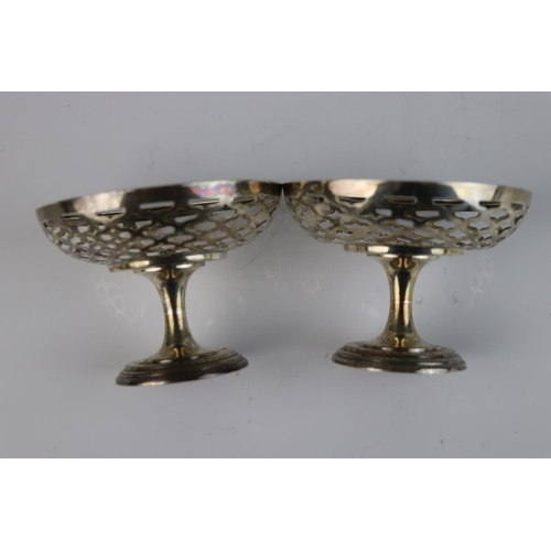 331 - A pair of fully hallmarked sterling silver bonbon dishes with pierced decoration, maker marked for A...