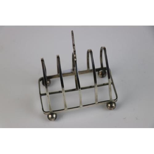 334 - A fully hallmarked sterling silver toast rack, maker marked for John Collard Vickery, assayed in Bir...