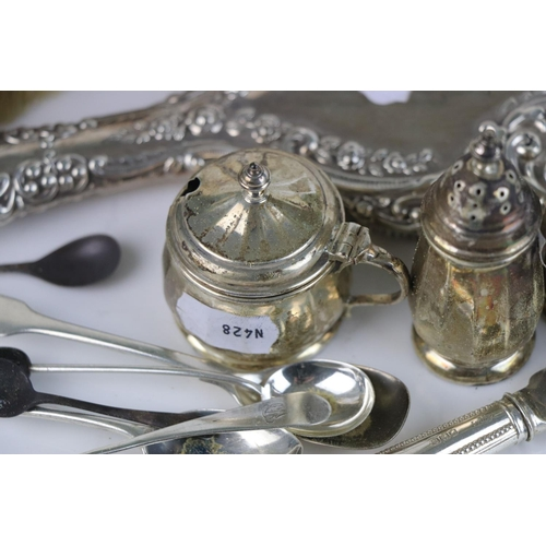 335 - A collection of fully hallmarked sterling silver to include a brush and mirror set and a cruet set.