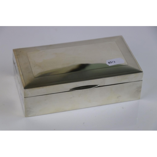 336 - A fully hallmarked sterling silver cigarette box with engine turned decoration, maker marked for Dea...