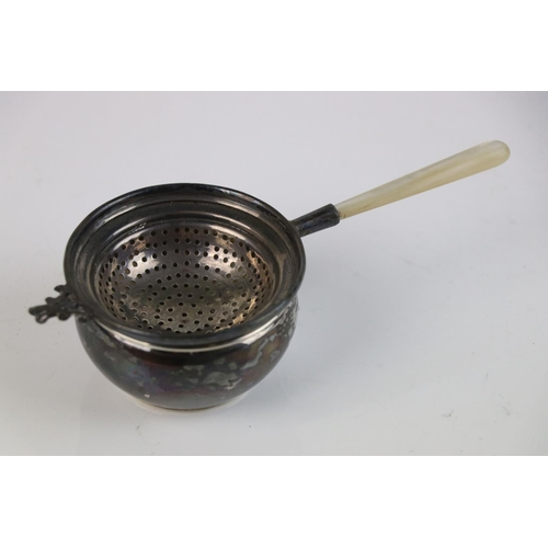 337 - A fully hallmarked sterling silver tea strainer with mother of pearl handle, maker marked for S. Bla...