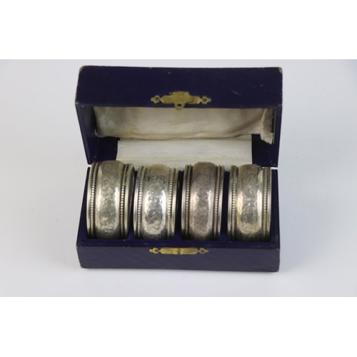 348 - A fully hallmarked sterling silver cased set of four napkin rings, maker marked for William Aitken, ...