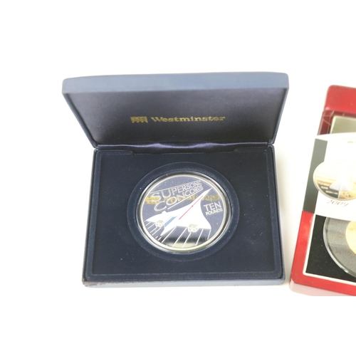 449 - A cased Silver proof gold plated Concorde Piedfort £5 coin complete with C.O.A. together with a case...