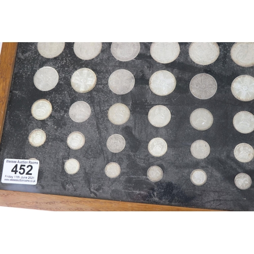 452 - A framed and glazed British pre-decimal silver coin collection to include all Half Crown, One Florin...