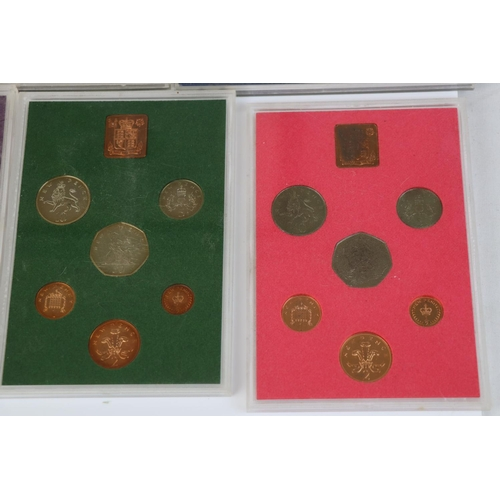 455 - A collection of ten Royal Mint coin year sets to include 1963, 1957, 1973, 1975, 1970, 1977, 1965, 1...