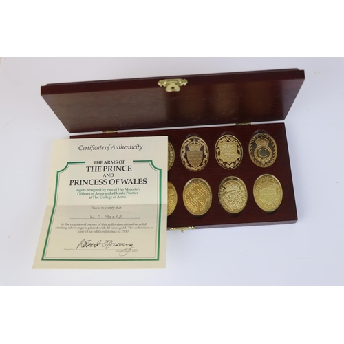 466 - A cased Danbury Mint fully hallmarked silver gilt set of twelve ingots featuring the arms of the Pri...