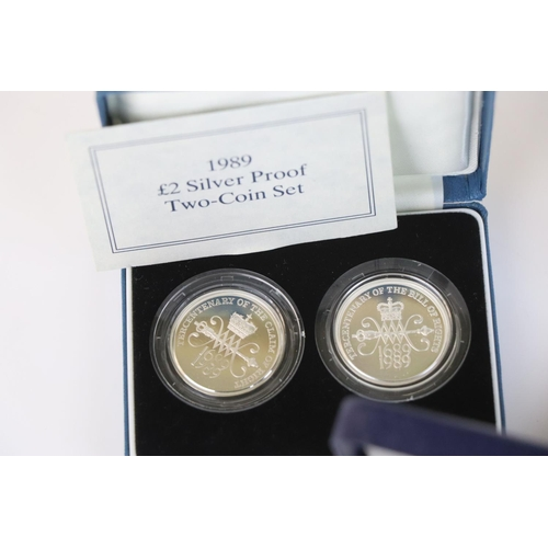 467 - Three cased Royal Mint silver proof coin sets to include the 1992-1993 silver proof fifty pence coin...