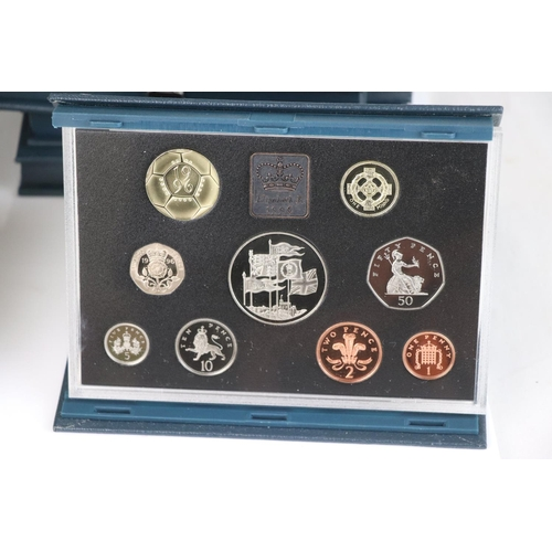 473 - A collection of thirteen Royal Mint UK proof coin collection year sets to include 1985, 1988, 1989, ...
