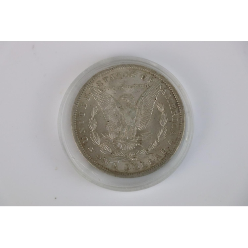 503 - A United States of America 1885 Morgan dollar with New Orleans mint mark.