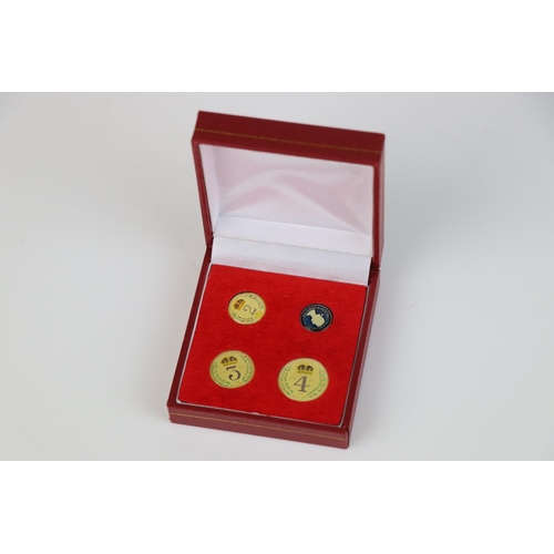 510 - A Queen Elizabeth II finely enamelled silver 1987 Maundy money four coin set.