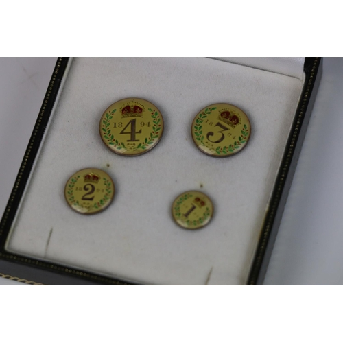 514 - A Victorian finely enamelled silver 1894 Maundy money four coin set.