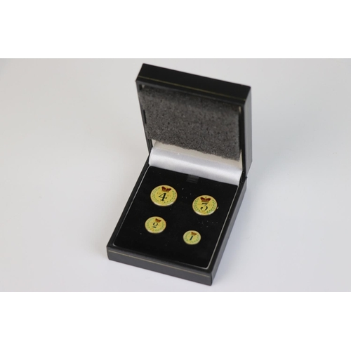 515 - A Victorian finely enamelled silver 1887 Maundy money four coin set.