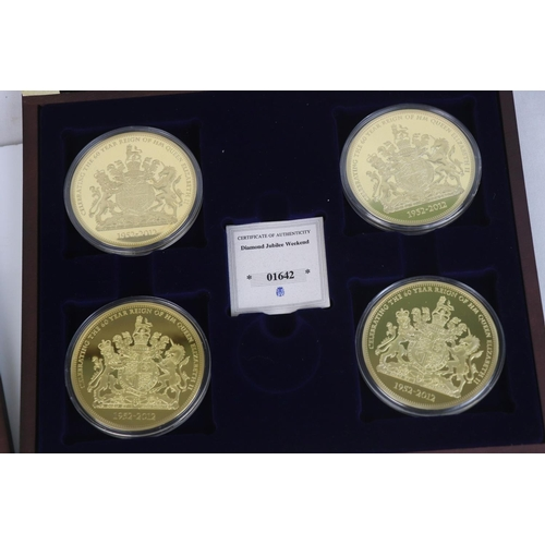 517 - A Windsor Mint The Diamond Jubilee Weekend limited edition commemorative four coin set together with...